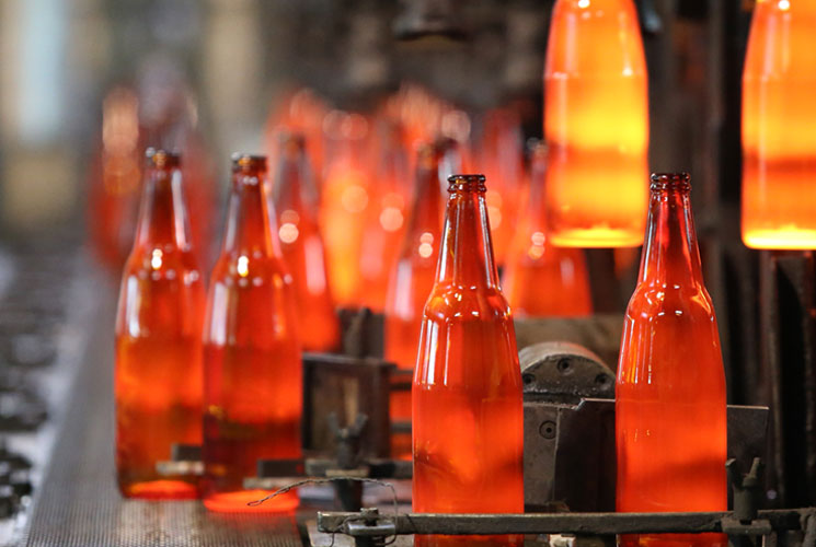 Glass bottles being manufactured